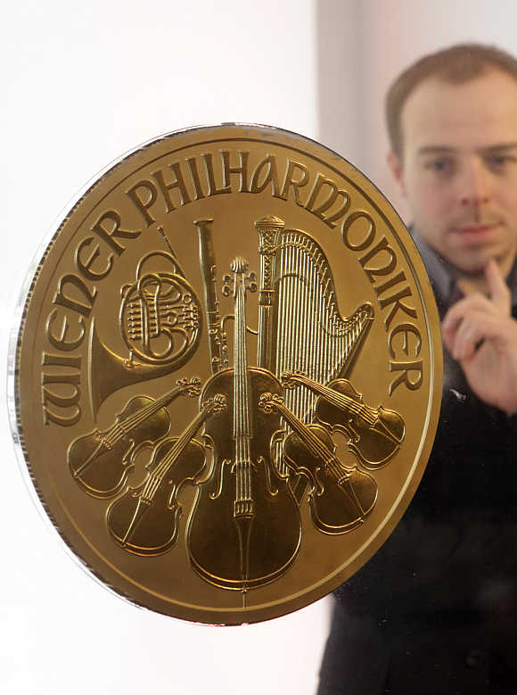 A man looks at Europe's largest gold coin in a shop in Vienna