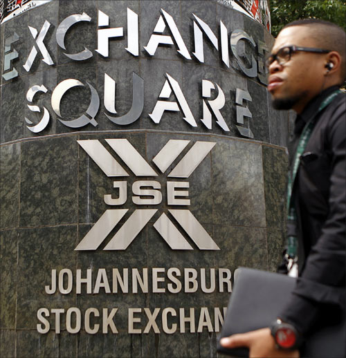 A man walks past the Johannesburg Stock Exchange building in Sandton.
