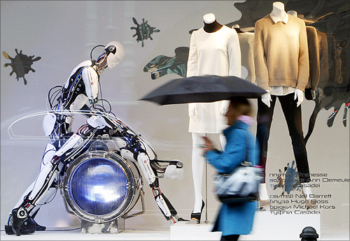 A pedestrian walks past a window display at a shopping mall in central Moscow.