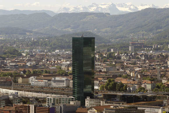 A view of the Prime Tower office building in Zurich in front of the eastern Swiss Alps