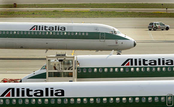 Alitalia aeroplanes taxi at Malpensa Airport on the outskirts of Milan, Italy.