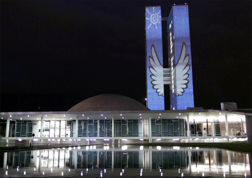 An image is projected on the towers of the National Congress during Culture Week in Brasilia.