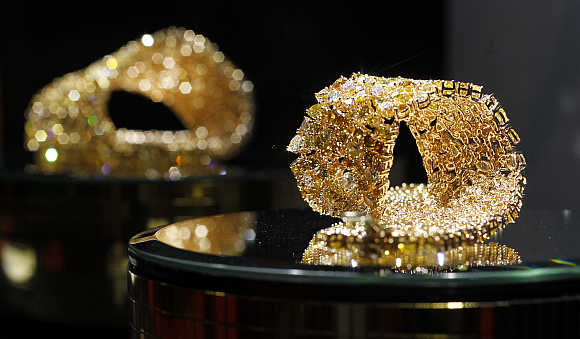Gold jewellery on a stand at the Valenza international jewels exposition in Valenza, northern Italy.