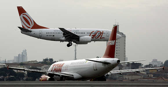 A TAM airlines Airbus A320 taxies to take off as a Gol