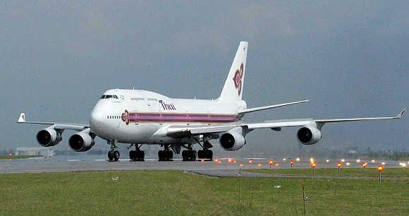 A Thai Airway's Airbus plane lands at the Suvarnabhumi airport in Bangkok.