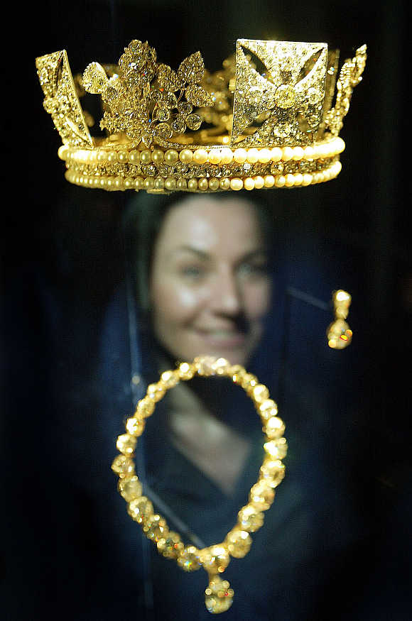 A woman looks at the Diamond Diadem Crown