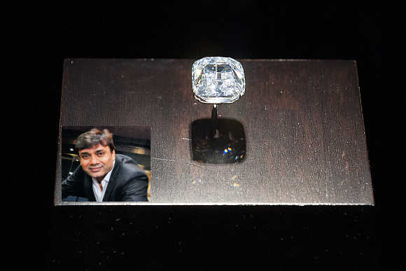 Arch Duke Joseph diamond sits on display at Christie's auction house in New York. Mavji Bhai Patel, inset.