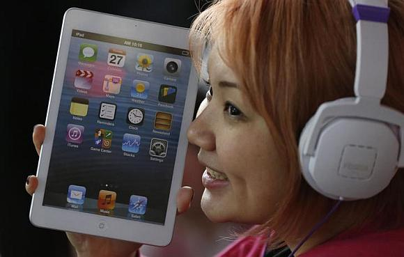 Apple's new iPad mini as she waits for the release of the tablet.