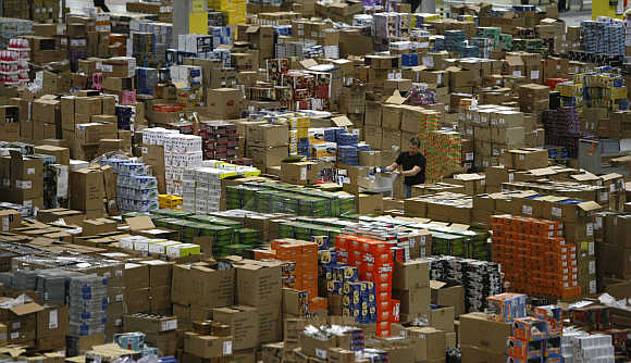 A worker sorts packages at the Amazon warehouse in Leipzig, Germany.