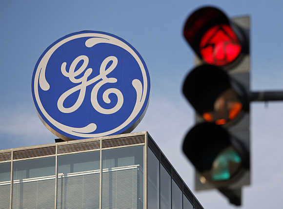 Logo of GE Money Bank is seen behind a traffic light in Prague, the Czech Republic.
