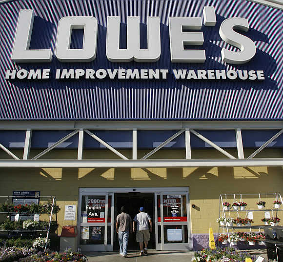 Two customers enter a Lowe's store in Burbank, California.