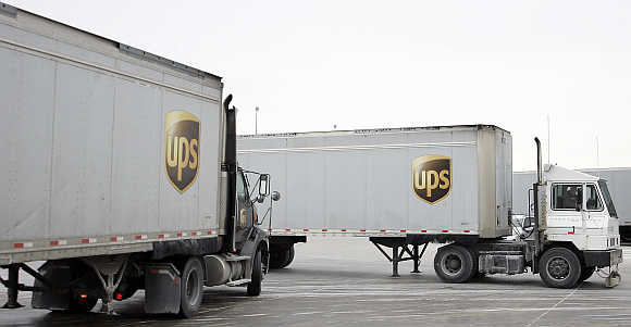 Trucks enter and leave the UPS facility in Hodgkins, Illinois, United States.