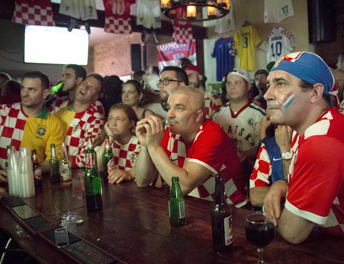 Croatian fans react to being behind late in the opening soccer match of the 2014 World Cup in the Astoria neighborhood of Queens, New York