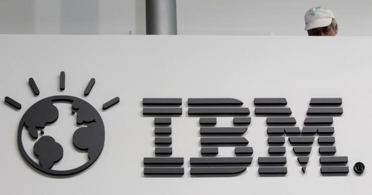 A man walks past the headquarters of IBM Japan in Tokyo.
