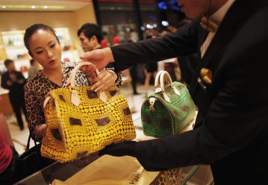 A woman shops in a Louis Vuitton store in downtown Shanghai.