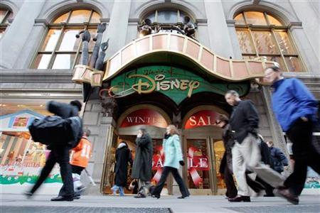 Passers-by walk in front of the World of Disney store in New York