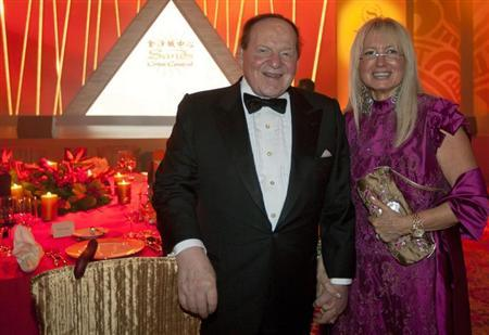 Sheldon Adelson with his wife Miriam attend the opening ceremony of the Four Seasons Macao hotel and casino in Macau.