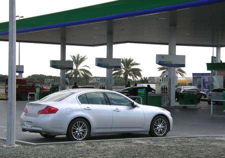 Vehicles queue for petrol at an Emarat gas station in Dubai.